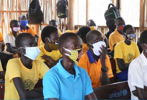 A classroom of students wearing protective face masks