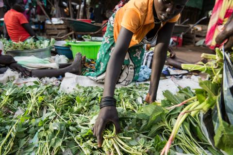 In South Sudan, women sell wild greens at a market.