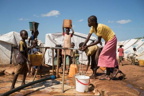 Women and children collect water in the United Nations Protection of Civilians Site that house over 30,000 displaced people in Wau, South Sudan, July 30, 2016.