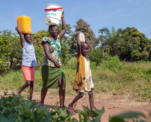 Three children carry water