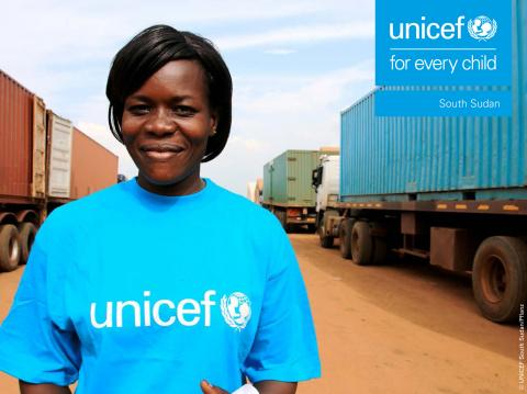 Report cover, a UNICEF employee in a blue UNICEF shirt stands in front of supply trucks