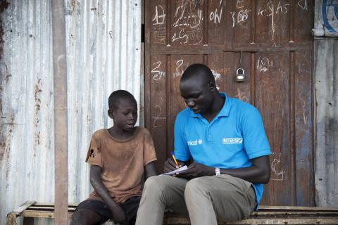 Simon Char, a social worker for Intersos, is registering an unaccompanied boy living in the Malakal PoC.