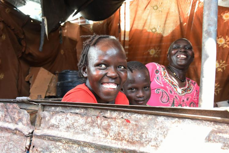 Ferdos, Chogi and their mother Khamisa are happy with their new life in Malakal, together.