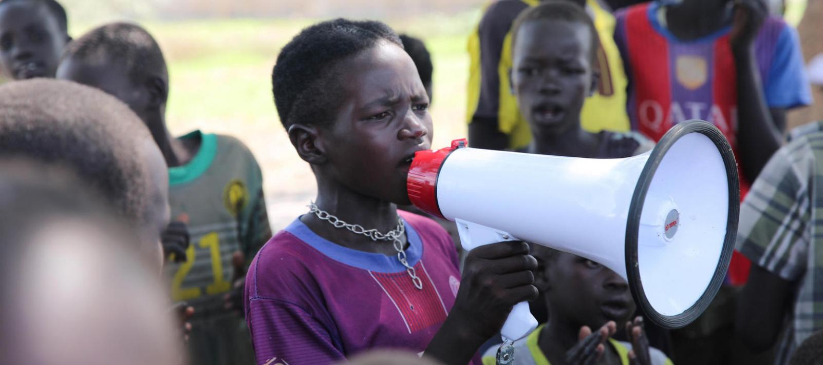 Children advovate through songs and messages promoting a back-to-school initiative