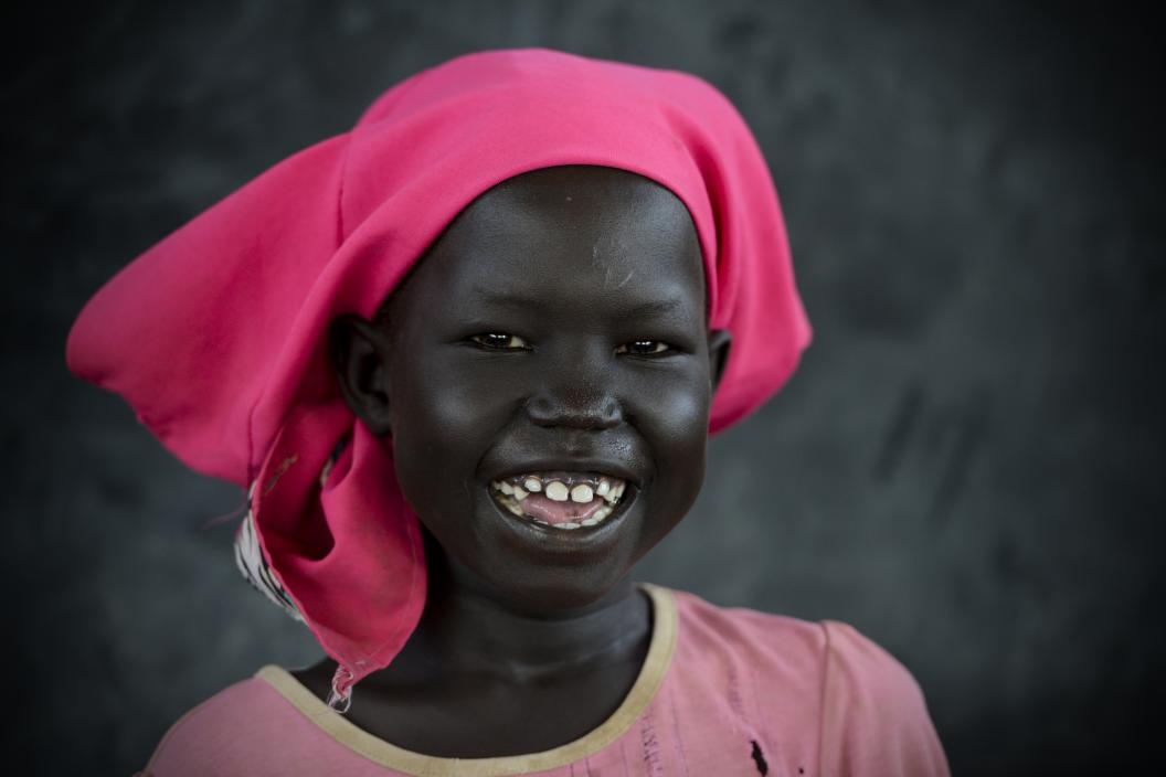 A South Sudanese girl is smiling