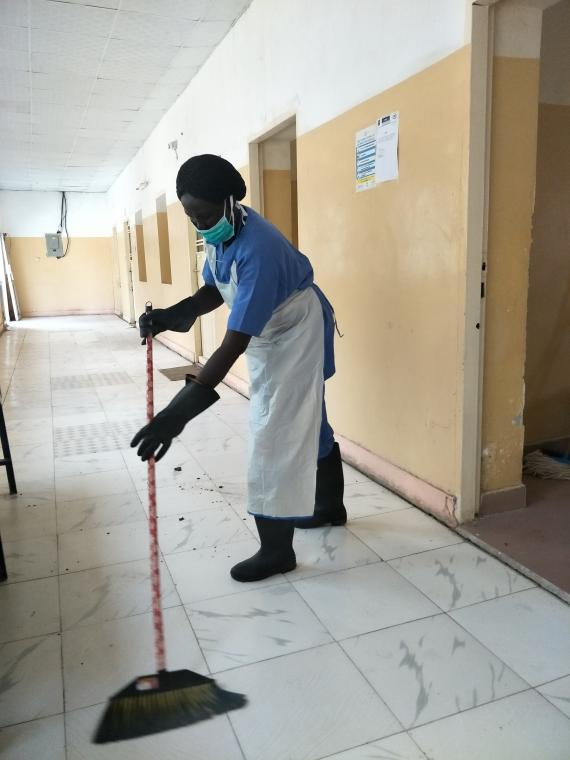 A woman cleaning the floor