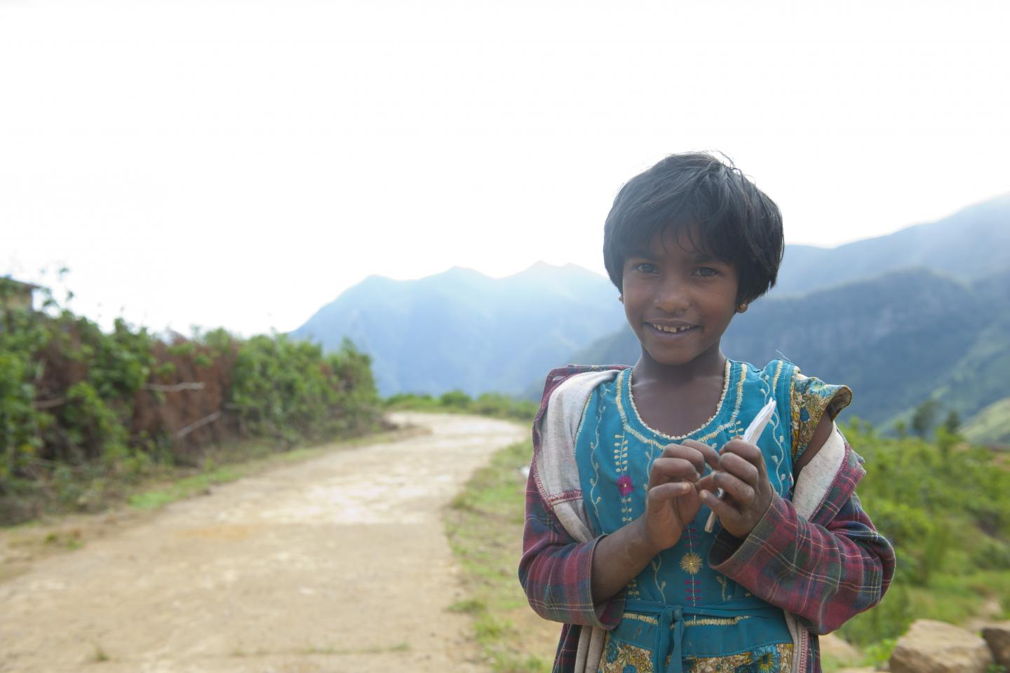 Young girl in a remote village that is hard to access