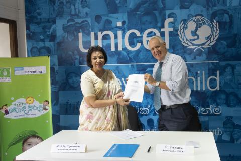 Ms. Amari Wijewardene, Chairperson of The Swadeshi Industrial Works PLC and  Mr. Tim Sutton, Representative, UNICEF Sri Lanka sign the formal agreement that will see 80-year-old Sri Lankan herbal baby care brand Swadeshi Khomba Baby join forces with the United Nations Children's Fund (UNICEF) to ensure that parents across Sri Lanka will have access to the information they need to support their child's development, and give them the best possible start in life, through the BetterParenting.lk platform.