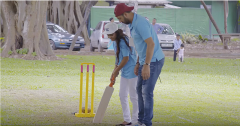 Yuvraj Singhe teaching a girl to bat