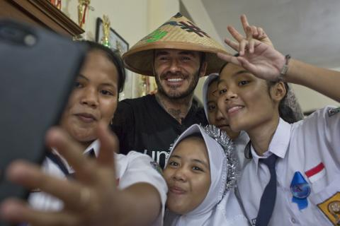 Unicef Goodwill Ambassador David Beckham poses with students