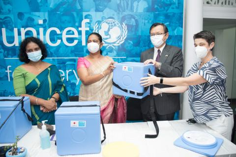 Minister of Health Sri Lanka, Pavithra Wanniarachchi receiving vaccine carriers from Mr. SUGIYAMA Akira, Ambassador of Japan to Sri Lanka and Ms. Emma Brigham, UNICEF Sri Lanka Representative, a.i. Dr.(Mrs.) T.L.C. Somatunga, Additional Secretary (Public Health Services), Ministry of Health also present in this occasion.