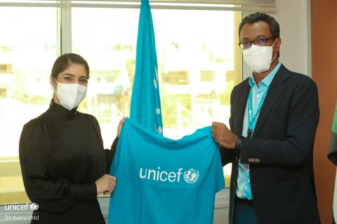 Maha holding the unicef shirt