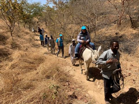 UNICEF Staff walking and using donkeys to hard to reach areas