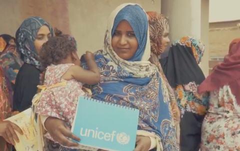 Woman holding unicef notebook