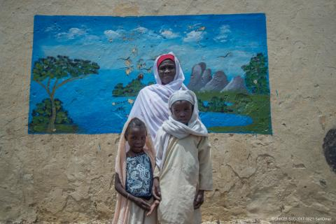 Mother and her two daughters in Sudan