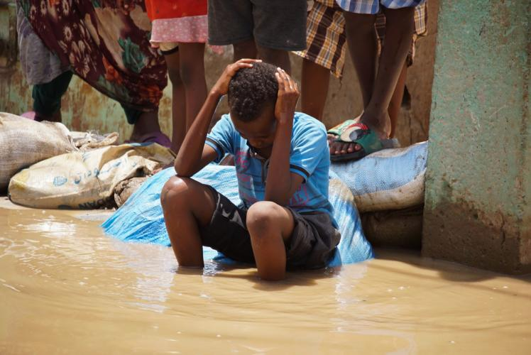 Child in flood water