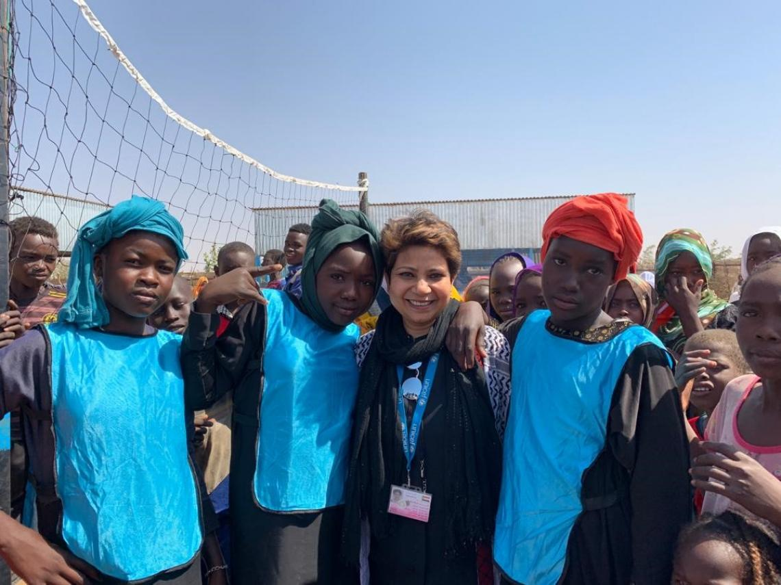 Deputy rep with adolescents in Sudan