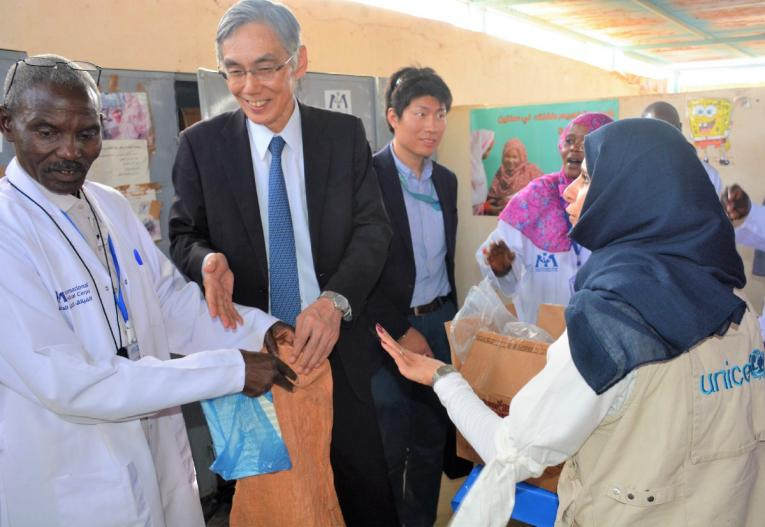 H.E. learning more about the Hamedia 2's services with UNICEF and partners.