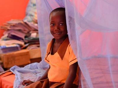Margaret Agyapong, (6) in the bedroom where she and her siblings sleep under a long-lasting insecticide-treated bed net (LLI) in the village of Ankaase in the Western Region of Ghana, in October 2012.