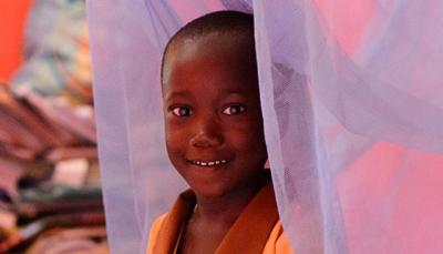 Six-year old Margaret Agyapong in the bedroom where she and her siblings sleep under a long-lasting insecticide-treated bed net, in the village of Ankaase, Ghana, October 2012.