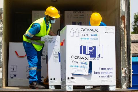 On Friday 26 February 2021, two men work in the offload of a shipment of COVAX COVID-19 vaccines at a UNICEF-supported warehouse in Abidjan, Cote d'Ivoire.
