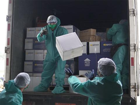 Delivery of liquid and gel alcohol to be used by children and teenagers in Ecuador.