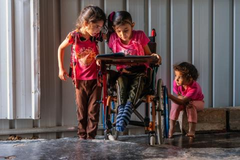 Za'atari refugee camp, Jordan, December 2020: Aseel, 8, on her wheelchair and her two younger sisters.