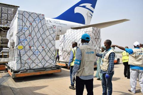 At an airport, in April 2020, UNICEF Nigeria staff receives a delivery of vital health supplies to support the fight against the COVID-19 pandemic.