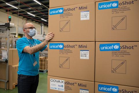 Unicef staff checking the boxes containing syringes. Fraga, Spain, 22 February 2021.