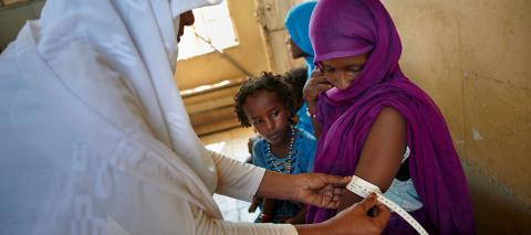 A midwife takes MUAC measurements from a young woman who is Alowia Mohammed Omar who is 6-month pregnant, at Tindlaye Health Unit (MCH) in Aroma Locality, 75 km North-East of Kassala, the capital of the state of Kassala in Eastern Sudan.