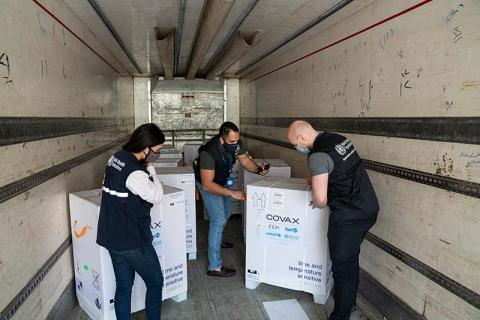 On 21 April 2021, three WHO staff members inspect the first shipment of COVID-19 vaccines for the COVAX Facility in Jdaydet Yabous, a village situated on the border between Syria and Lebanon, in the rural area of Damascus.