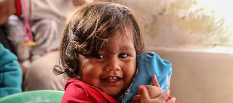 Aranza Benavente, 1 year old, received one of the sanitation kit distributed by UNICEF.