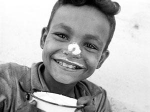 A smiling eight-year-old boy has milk on his nose - Guatemala 1950