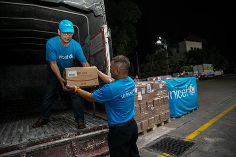 UNICEF staff and representatives from the National Institute of Nutrition (NIN) are loading emergency supplies of RUTF on trucks in Hanoi to be dispatched to health centers in the flood and storm-stricken region of central Viet Nam, in November 2020.