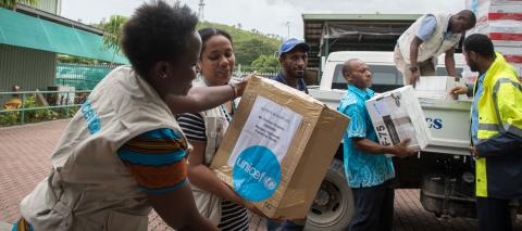 UNICEF staff unloading emergency supplies in Port Moresby, Papua new Guinea for earthquake response efforts, in March 2018.