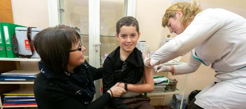 Ruslan Poliuga, 14, receive his MMR vaccine against measles, mumps and rubella from a mobile brigade of healthcare professionals on 26 February 2019 in Mykolaiv Gymnasium, Lviv region, Ukraine.