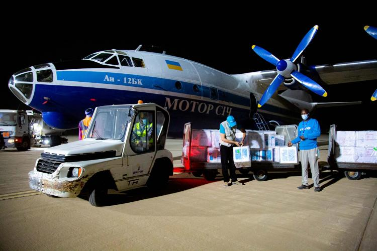 UNICEF staff support the delivery of a special charter of vaccines at Nouakchott airport, Mauritania in June 2020.