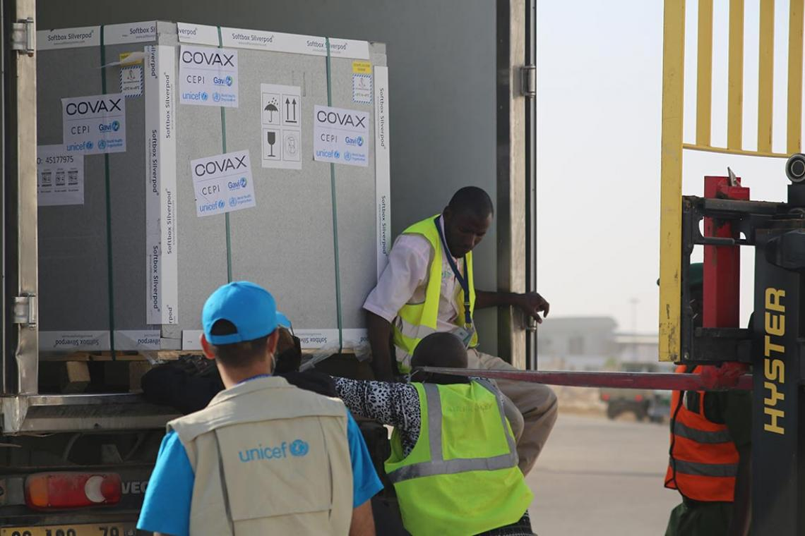UNICEF staff receives donated COVID-19 vaccine doses from France in Nouakchott International Airport, Mauritania.