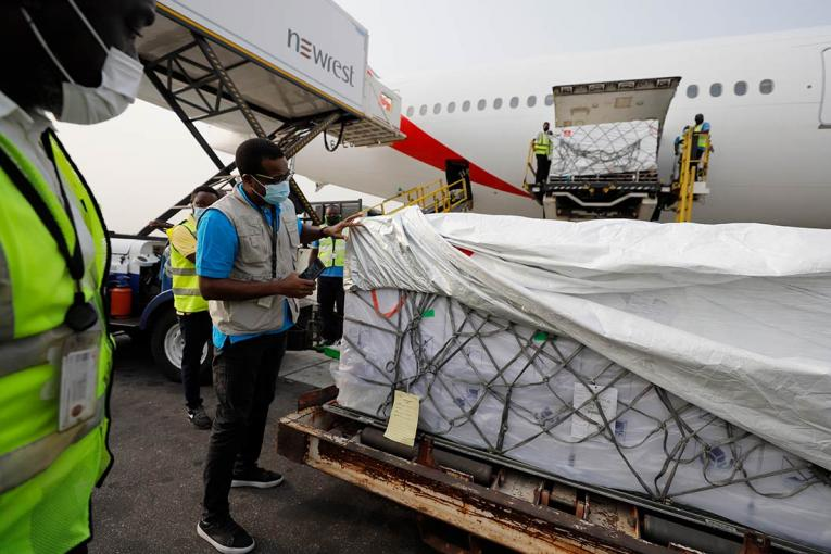 On 24 February 2021, a UNICEF staff inspects the first shipment of COVID-19 vaccines distributed by the COVAX Facility at Kotoka International Airport in Accra, Ghana's capital.