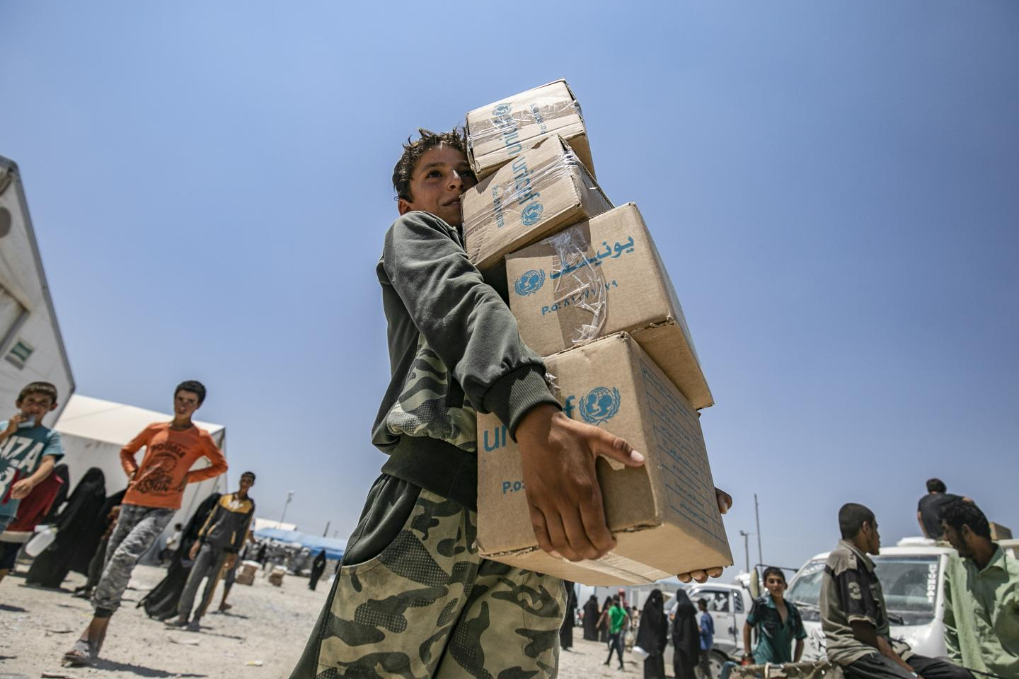 child holding UNICEF boxes