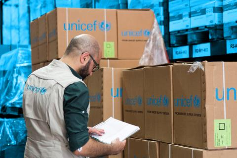 UNICEF staff works at a warehouse