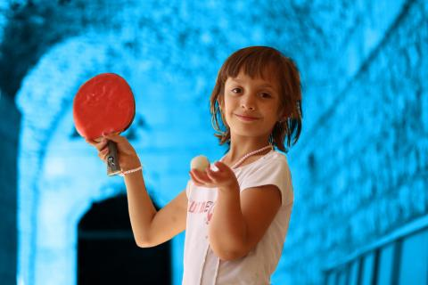 girl with disability playing ping pong