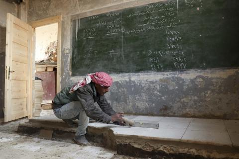 worker rehabilitating a classroom