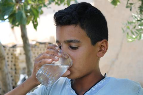 child drinking glass of water
