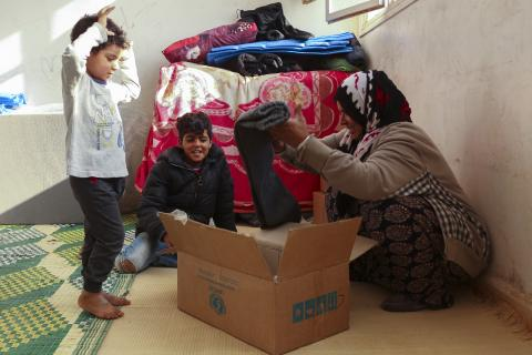family trying UNICEF new cloths
