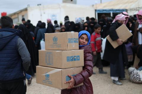 girl carrying UNICEF boxes