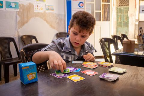 child playing cards game