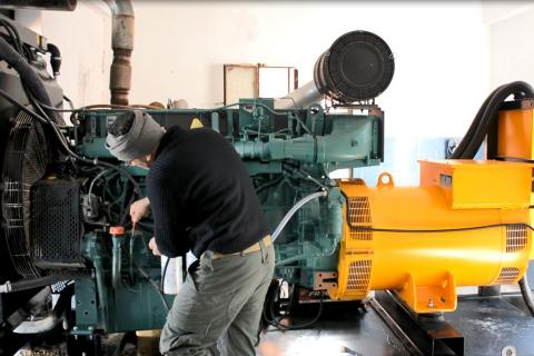 technician fixing water pump