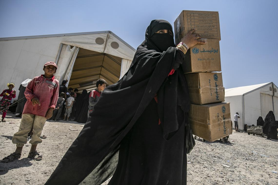 woman holding UNICEF boxes