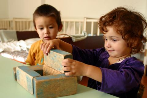 boy and girl playing with blocks